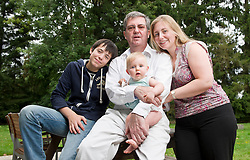 """Dr. Stephane Huberty, with his wife, Leone, their daughter Isalyne, and his son Arnaud, at their home in Rixensart, Belgium, on August 7, 2010. Dr. Huberty suffers from myasthenia gravis, a rare neurological condition. It is one of more than 5,000 """"orphan"""" diseases, so called because there are so few sufferers that most pharmaceutical companies are reluctant to invest in cures. The 48-year-old Belgian doctor, who has had the disease for 14 years, has been taking medication he and others developed, but he can't find investors to pay for a clinical trial. Pharmaceutical companies and other doctors say his product is unproven. So Dr. Huberty is taking a leaf out of 19th- century science and using himself as a guinea pig, and the results have been very positive thus far. (Photo © Jock Fistick)"""