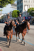 """Hollywood, CA, Police patrol on horseback, """"Hollywood Boulevard"""" CA, Stars, """"Walk of Fame"""" Los Angeles, Ca,  entertainment, tourist, attractions, sightseeing, ,Vertical image"""