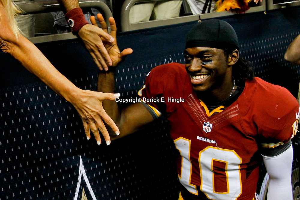 September 9, 2012; New Orleans, LA, USA; Washington Redskins quarterback Robert Griffin III (10) celebrates following a win over the New Orleans Saints at the Mercedes-Benz Superdome. The Redskins defeated the Saints 40-32. Mandatory Credit: Derick E. Hingle-US PRESSWIRE