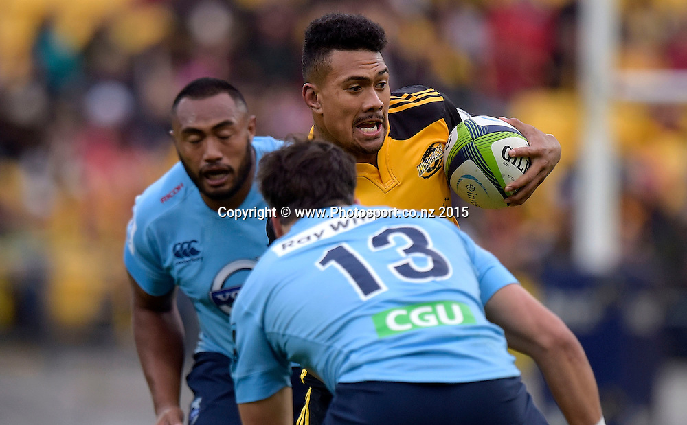 Hurricanes' flank Ardie Savea (C runs through Waratahs' Tolu Latu (L) and Adam Ashley-Cooper during the Super Rugby - Hurricanes v Waratahs rugby union match at the Westpac Stadium in Wellington on Saturday the 18th of April 2015. Photo by Marty Melville / www.Photosport.co.nz