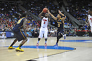 Ole Miss' Derrick Millinghaus (3) vs. La Salle's Tyreek Duren (3) in the Round of 32 of the NCAA Tournament at the Sprint Center in Kansas City, Mo. on Sunday, March 24, 2013.