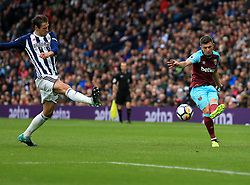 Aaron Cresswell of West Ham United puts in a cross as Grzegorz Krychowiak of West Bromwich Albion tries to block - Mandatory by-line: Paul Roberts/JMP - 16/09/2017 - FOOTBALL - The Hawthorns - West Bromwich, England - West Bromwich Albion v West Ham United - Premier League