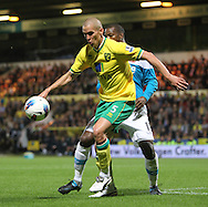 Picture by Paul Chesterton/Focus Images Ltd.  07904 640267.26/9/11.Steve Morison of Norwich and Titus Bramble of Sunderland in action during the Barclays Premier League match at Carrow Road stadium, Norwich.