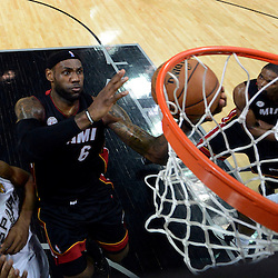 Jun 13, 2013; San Antonio, TX, USA; Miami Heat small forward LeBron James (6) shoots against San Antonio Spurs small forward Kawhi Leonard (2) during the first half of game four of the 2013 NBA Finals at the AT&T Center. Mandatory Credit: Derick E. Hingle-USA TODAY Sports