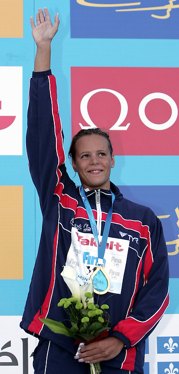 France's Laure Manaudou waves from the medal stand after the final of the women's 400m Freestyle at the FINA World Championships in Montreal, Canada Sunday 24 July, 2005. Manaudou won the gold medal, Ai Shibata of Japan won the silver medal and Caitlin McClatchey of Great Britain won the bronze. (Photo by Patrick B. Kraemer / MAGICPBK)