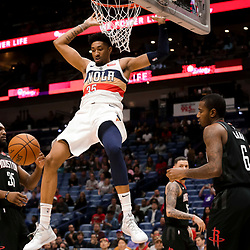Mar 24, 2019; New Orleans, LA, USA; New Orleans Pelicans forward Christian Wood (35) dunks over Houston Rockets forward Gary Clark (6) and forward Kenneth Faried (35)during the second half at the Smoothie King Center. Mandatory Credit: Derick E. Hingle-USA TODAY Sports