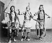 Three Native American men in traditional clothing, posed as if performing a snake dance, photograph by the Gerhard Sisters, Emme Gerhard, 1872–1946, and Mayme Gerhard, 1876–1955, in the Anasazi Heritage Center, an archaeological museum of Native American pueblo and hunter-gatherer cultures, Dolores, Colorado, USA. Picture by Manuel Cohen