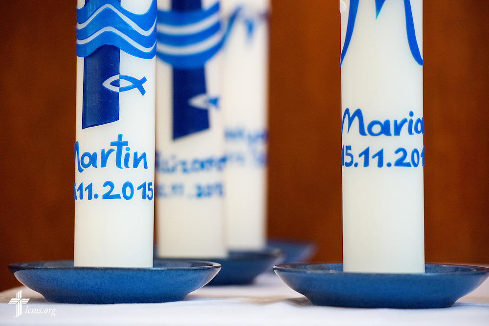 Baptism candles with the Christian name of Muslim converts on Sunday, Nov. 15, 2015, at the Dreieinigkeits-Gemeinde, a SELK Lutheran church in Berlin-Steglitz, Germany.  LCMS Communications/Erik M. Lunsford