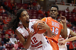21 November 2015: Tony Wills(12) reels in a rebound in front of Trey Patterson(10). Illinois State Redbirds host the Houston Baptist Huskies at Redbird Arena in Normal Illinois (Photo by Alan Look)