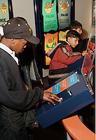 Year 6 pupils answer health questions on an interactive exhibit at the Thackray Medical Museum in Leeds....