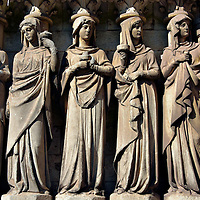 Sculptures Adorning Saint Fin Barre&rsquo;s Cathedral in Cork, Ireland<br /> There are over 1,250 sculptures outside and inside of Saint Fin Barre&rsquo;s Cathedral. This ensemble is five of them on the western fa&ccedil;ade.  They are called the Wise Virgins, representing those who are prepared for Judgement Day. Many of these works were carved by Thomas Nicholls.  He is the same 19th century sculptor who adorned the Cardiff Castle, created the first phase of the Animal Wall in Cardiff plus decorated Castell Coch in Wales.  All of these works are shown on this website.