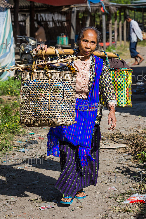 INLE LAKE, MYANMAR - DECEMBER 09, 2016 : woman tribe working at the five days market at the Inle Lake Shan state in Myanmar (Burma)