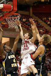 08 January 06  Michael Vandello jumps backwards between Ryan Martin and Kyle Wilson to get the ball to the glass...The Illinois State Redbirds come up short against the Witchita State Shockers.  The Shockers put on a 2nd half show that left the Redbirds trailing 56 - 47 at the bell.  Dana Ford of the Redbirds matched his career high with 16 points, adding 7 boards and 4 steals...Redbird Arena, Illinois State University  campus, Normal, Illinois...