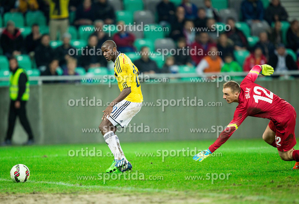 Adrian Ramos of Colombia scoring against Jan Oblak of Slovenia for the first goal of Colombia during friendly football match between National teams of Slovenia and Colombia, on November 18, 2014 in SRC Stozice, Ljubljana, Slovenia. Photo by Vid Ponikvar / Sportida
