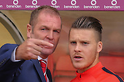 York City Manager Russell Wilcox talking to York City midfielder Josh Carson during the Sky Bet League 2 match between York City and Carlisle United at Bootham Crescent, York, England on 19 September 2015. Photo by Simon Davies.