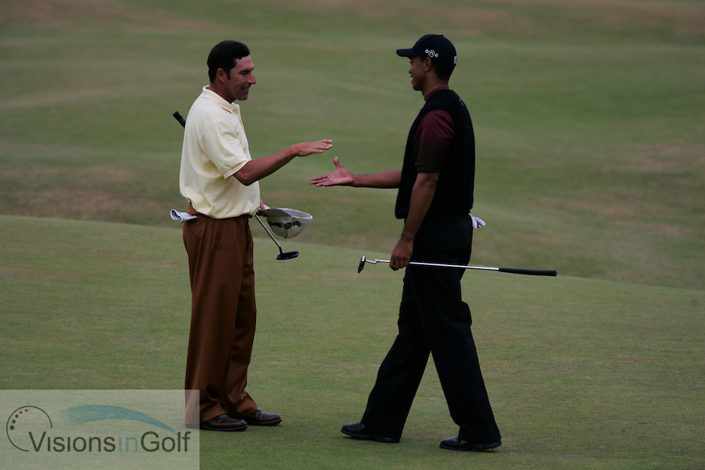 Tiger Woods after winning the tournament on the 18th green with Jose Maria Olazabal<br />
