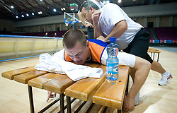 Uros Slokar and physiotherapist Teo Djekic  at practice of Slovenian National Basketball team in Arena Torwar two days before the beginning of the Eurobasket 2009, on September 05, 2009 in Warsaw, Poland. (Photo by Vid Ponikvar / Sportida)