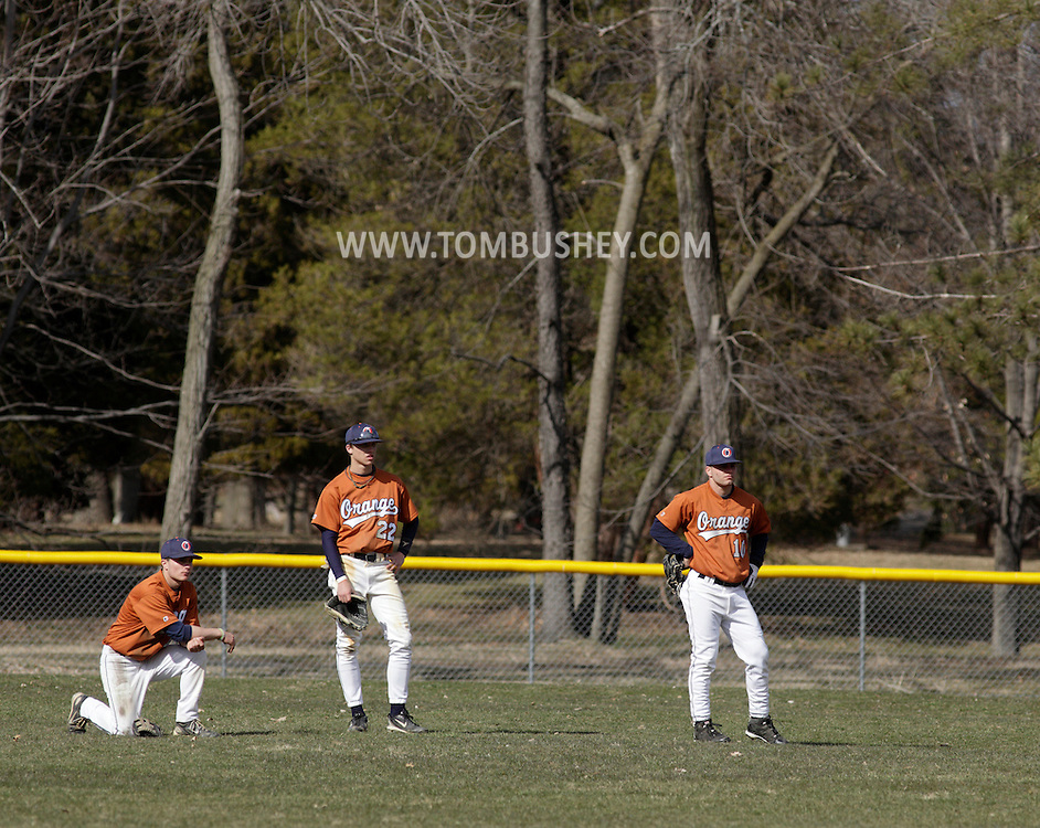 Middletown, New York - Three Orange County Community College baseball players watch from the outfield during a break in their game against Sullivan County Community College in on April 2, 2011.