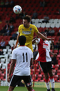 AFC Wimbledon midfielder Chris Whelpdale (11) jumps highest during the Pre-Season Friendly match between Woking and AFC Wimbledon at the Kingfield Stadium, Woking, United Kingdom on 29 July 2016. Photo by Stuart Butcher.