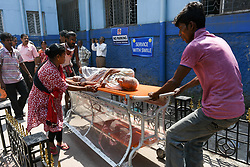 October 3, 2018 - Kolkata, West Bengal, India - Patients are been evacuted to safer location,away from the fire and smoke. A major fire broke out at the pharmacy inside the Calcutta Medical College hospital, near the Emergency ward, which forced the hospital authorities to evacuate more than 100 patients. (Credit Image: © Debarchan Chatterjee via ZUMA Wire)