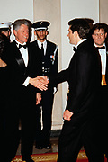 U.S. President Bill Clinton, left, shakes hands with John Kennedy, Jr. in the receiving line during the State Dinner at the White House February 5, 1998 in Washington, DC.