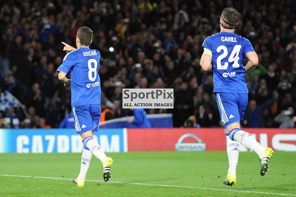 Chelseas Oscar and Gary Cahill celebrates Oscars penalty putting their side 2-0 during the Chelsea v Maccabi Tell-Aviv champions league match in the group stage.