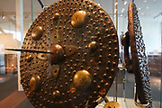 Spiked shield. The Culloden Battlefield visitor center is run by the National Trust for Scotland, near Inverness, United Kingdom, Europe. The Battle of Culloden on 16 April 1746 was part of a religious civil war in Britain and was the final confrontation of the Jacobite rising of 1745. It was the last pitched battle on British soil, and in less than an hour about 1500 men were slain – more than 1000 of them Jacobites. After an unsuccessful Highland charge against the government lines, the Jacobites were routed and driven from the field. Today, strong feelings are still aroused by the battle and the brutal aftermath of weakening Gaelic culture and undermining the Scottish clan system. Three miles south of Culloden village is Drumossie Moor, often called Culloden Moor, site of the battle. Culloden is in Scotland 5 miles east of Inverness, off the A9/B9006, directed by brown signs.