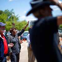Thomas Wells | BUY at PHOTOS.DJOURNAL.COM<br /> Jacky O'Neal of Tupelo raises her hand while singing along during the closing song on Thursday National Day of Prayer gathering at Tupelo City Hall.