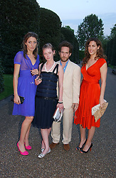 Left to right, DIXIE CHASSAY, CAMILLA RUTHERFORD,  Actor TOM HOLLANDER and JESSICA DE ROTHSCHILD at a party to celebrate the opening of Roger Vivier in London held at The Orangery, Kensington Palace, London on 10th May 2006.<br />