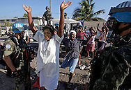 Earthquake aftermath in Haiti on Sunday, January 24, 2010..The Brazilian Battalion and and the US Army in Cite Soleil join for a food distribution on Sunday morning. These women are rejoicing and praising the Brazialians for the aid.