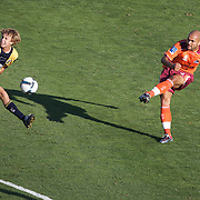 Sergio Van Dijk scores Brisbane's second goal shooting past Matthew Lewis during the Central Coast Mariners V Brisbane Roar A-League match at Bluetongue Stadium, Gosford, Australia, 19 December 2009. Photo Tim Clayton