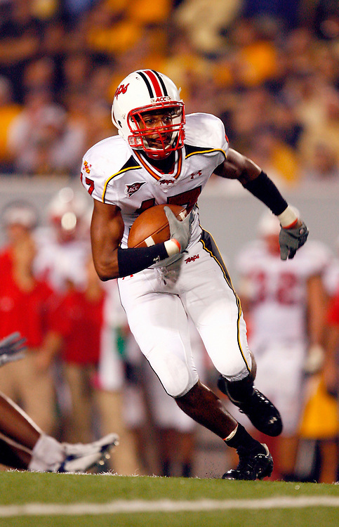 MORGANTOWN, WV - SEPTEMBER 14: Running Back Taji Thorton #27 of the Maryland Terrapins rushes against the West Virginia Mountaineers at Milan Puskar Stadium, the home of Mountaineer Field, on September 14, 2006 in Morgantown, West Virginia. West Virginia defeated Maryland 45 to 24.  *** Local Caption *** Taji Thorton