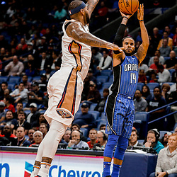 Oct 30, 2017; New Orleans, LA, USA; Orlando Magic guard D.J. Augustin (14) shoots over New Orleans Pelicans forward DeMarcus Cousins (0) during the first quarter of a game at the Smoothie King Center. Mandatory Credit: Derick E. Hingle-USA TODAY Sports