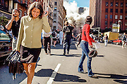 Distraught people evacuate the area around World Trade Center as others look on in horror as the WTC North Tower collapse, following the attack on September 11th.