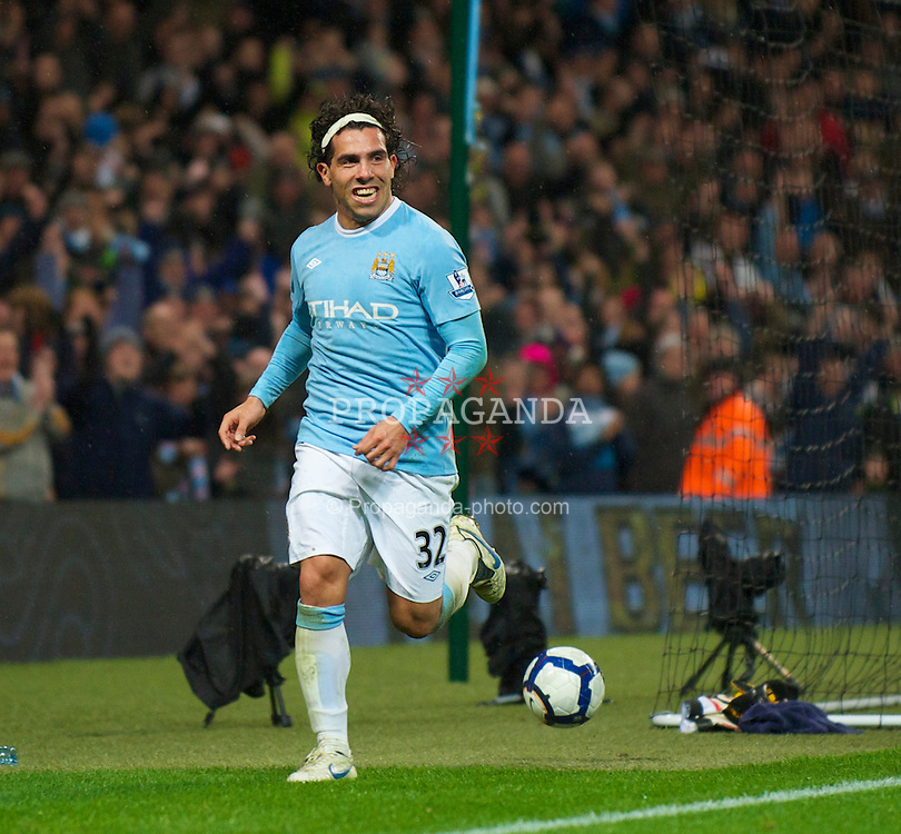 WIGAN, ENGLAND - Monday, March 29, 2010: Manchester City's man-of-the-match Carlos Tevez celebrates scoring the second goal of his hat-trick against Wigan Athletic during the Premiership match at the City of Manchester Stadium. (Photo by David Rawcliffe/Propaganda)