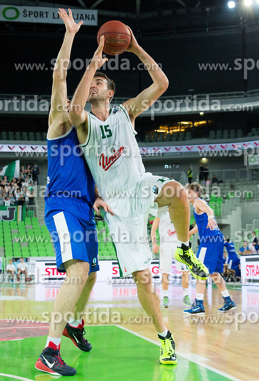 Mirza Begic #15 of KK Union Olimpija during basketball match between KK Union Olimpija (SLO) and Zenit St. Petersburg (RUS) in 4th Round of EuroCup 2014/15, on November 4, 2014 in Arena Stozice, Ljubljana, Slovenia. Photo by Vid Ponikvar / Sportida