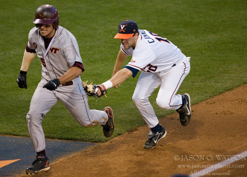 Virginia Cavaliers INF Tyler Cannon (10) tags out Virginia Tech's Matt Hacker (5) along the third base line.  The #15 ranked Virginia Cavaliers baseball team defeated the Virginia Tech Hokies 10-1 at the University of Virginia's Davenport Field in Charlottesville, VA on March 28, 2008.