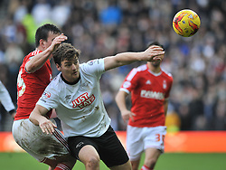 Derby County's Chris Martin is challenged by Nottingham Forest's Jack Hobbs - Photo mandatory by-line: Dougie Allward/JMP - Mobile: 07966 386802 - 17/01/2015 - SPORT - Football - Derby - iPro Stadium - Derby County v Nottingham Forest - Sky Bet Championship