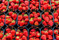 Strawberries for sale at Rue Cler street market, Paris, France.