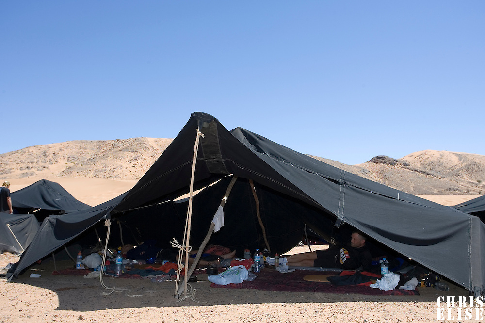 29 March 2007: Runners rest in their tents the day off after fourth and longest stage of the 22nd Marathon des Sables between jebel Zireg and west of Kfiroun (43.8 miles). The Marathon des Sables is a 6 days and 151 miles endurance race with food self sufficiency across the Sahara Desert in Morocco. Each participant must carry his, or her, own backpack containing food, sleeping gear and other material.