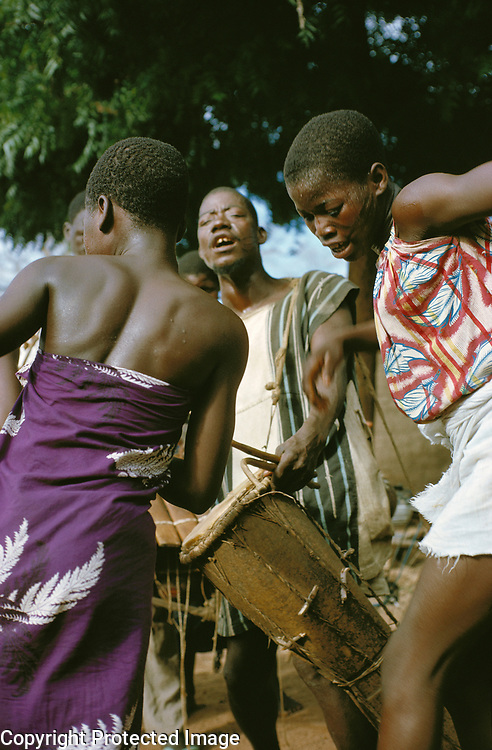 Girls of Bobo tribe dancing to the sound of drums and balafon xylophone in Koumbia, Burkina Faso, Africa.
