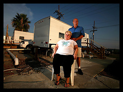 17 August 2006 - Slidell - Louisiana. Linda Spears (58 yrs) and her husband Charles (65 yrs) struggle in the cramped conditions of their FEMA trailer located on the site of their former home at 180a, Lakeview Drive. Hurricane Katrina wiped out the Spears' house, taking everything they owned. They are currently taking legal action against State Farm insurance company who have paid them a paltry $3,000 instead of settling with them for the insured value of their home and contents which total in excess of $230,000.<br />