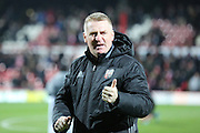 Brentford Head Coach Dean Smith giving thumbs up during the EFL Sky Bet Championship match between Brentford and Norwich City at Griffin Park, London, England on 31 December 2016. Photo by Matthew Redman.