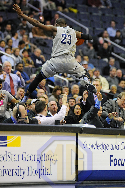 10 February 2014:   Georgetown Hoyas forward Aaron Bowen (23) leaps over the scorers table going for a loose ball in action against the Providence Friars at the Verizon Center in Washington, DC. where the Georgetown Hoyas defeated the Providence Friars, 83-71.