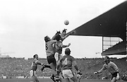 Three players meet mid air fighting for the ball during the All Ireland Senior Gaelic Football Final, Kerry v Dublin in Croke Park on the 28th September 1975. Kerry 2-12 Dublin 0-11.