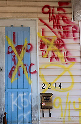 25 Oct,  2005.  New Orleans, Louisiana. Hurricane Katrina aftermath.<br /> The 8th ward lies in ruins following Katrina's devastating floods. Graffiti dated 9/11 marks '1 dead in attic' now crossed out following the later collection of the body.<br /> Photo; ©Charlie Varley/varleypix.com