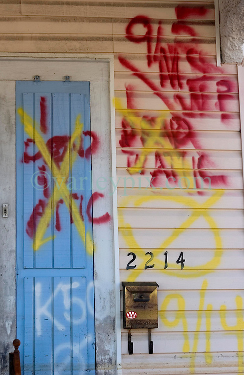 25 Oct,  2005.  New Orleans, Louisiana. Hurricane Katrina aftermath.<br /> The 8th ward lies in ruins following Katrina's devastating floods. Graffiti dated 9/11 marks '1 dead in attic' now crossed out following the later collection of the body.<br /> Photo; &copy;Charlie Varley/varleypix.com