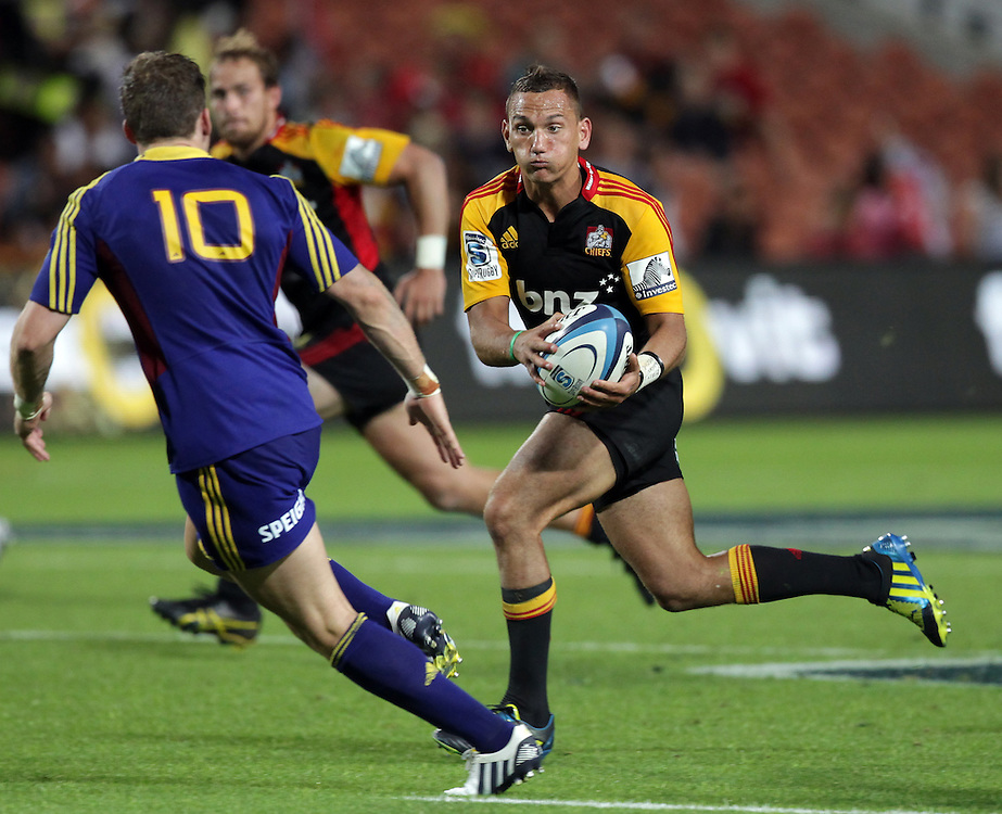 Chiefs' Aaron Cruden is about to be challenged by Highlanders' Colin Slade in a Super Rugby match, Waikato Stadium, Hamilton, New Zealand, Friday, March 22, 2013.  Credit:SNPA / David Rowland