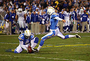 SAN DIEGO - JANUARY 03: Place kicker Nate Kaeding #10 of the San Diego Chargers kicks a fourth quarter field goal to tie the score at 17-17 during the AFC Wild Card playoff game against the Indianapolis Colts at Qualcomm Stadium on January 3, 2009 in San Diego, California. The Chargers defeated the Colts 23-17 in overtime. ©Paul Anthony Spinelli *** Local Caption *** Nate Kaeding
