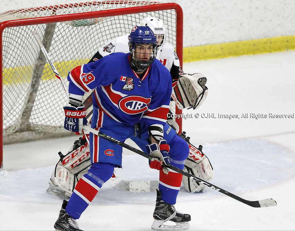 GEORGETOWN, ON  - MAR 18,  2017: Ontario Junior Hockey League, playoff game between the Georgetown Raiders and the Toronto Junior Canadiens. Jack McBain #19 of the Toronto Jr. Canadiens battles for position with Goalteder Nicholas Latinovich during the first period.<br /> (Photo by Tim Bates / OJHL Images)
